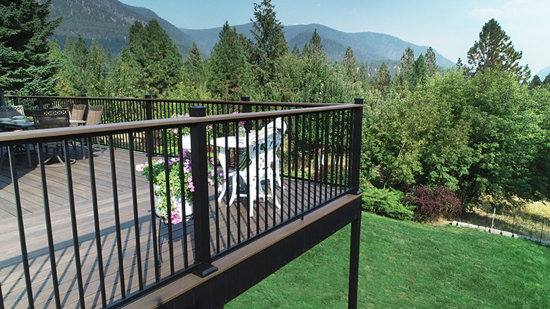 Fortress AL13 Home Panel Railing System installed on beautiful deck in the mountains