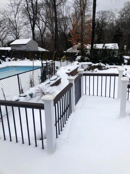 The level Trex Transcend composite railing creates a strong, sturdy look on your deck no matter the weather