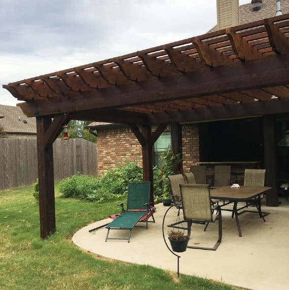 Create the perfect space to get away from it all with a cozy little patio pergola separating your space from the rest of the world