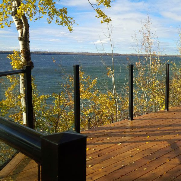The Century Scenic Glass Panel Railing delivers a deck railing that connects your deck with the nature beyond