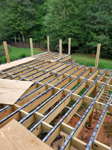 Cover and protect deck joists and beams with flashing tape or deck joist protection tape