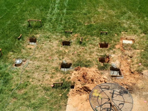 Creating deck post footings deep enough in the ground create a safe DIY deck build for upper-level spaces