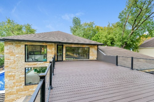 Rich Woodland Brown Trex Select composite decking creates a big open space for family and guests
