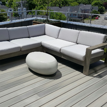 Browse the top decking material options available in 2020 and create a beautiful one-of-a-kind deck such as this outdoor space with Trex deck boards