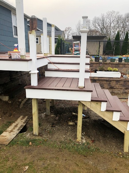 Slide Trex composite post sleeves over mounted deck posts creates a clean new look