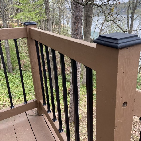 Installing metal deck balusters along your home's wooden railing is one way to step into the modern deck age