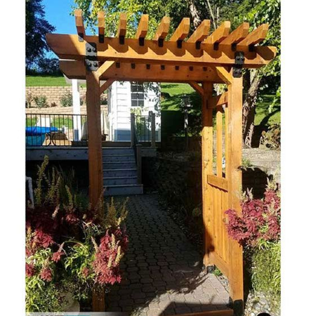Beautiful garden arbors from brands such as OZCO and Simpson Strong-Tie can create a gorgeous backyard space