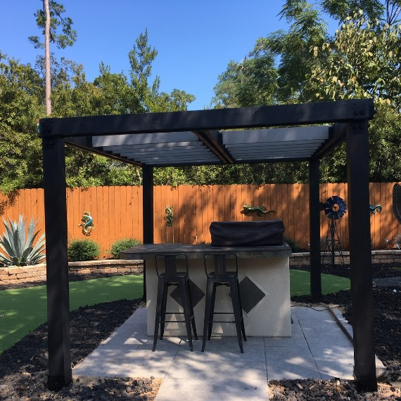 Design the perfect pergola for your space like this gorgeous outdoor bar and entertainment area