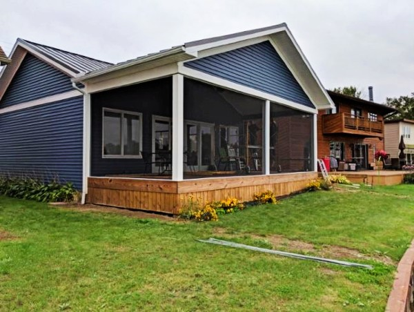 The SCREENEZE system creates a beautiful screened-in porch area