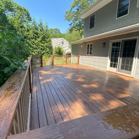 Check out what the most popular decking material options are for 2020 such as this Fiberon decking in Moringa staying strong against a morning rain