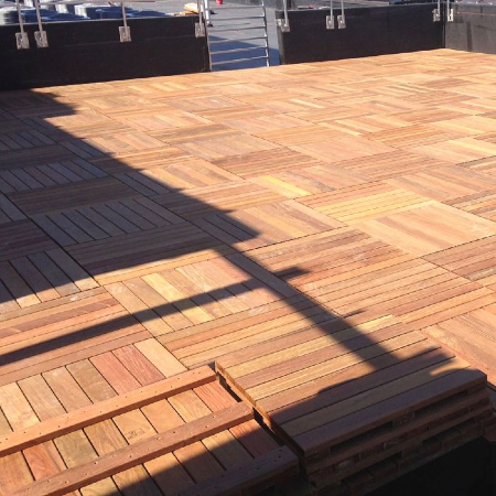 Wood deck tiles are an easy to install and highly durable deck flooring option to still highlight the beauty of natural wood
