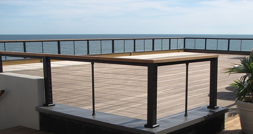 Beautiful black KeyLink Horizontal Cable Railing on an oceanview deck